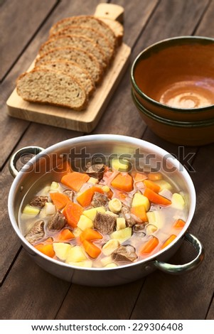 Traditional Hungarian soup called Gulyasleves made of beef, potato, carrot, onion, csipetke (homemade pasta) and seasoned with salt and paprika (Selective Focus, Focus one third into the soup) - stock photo