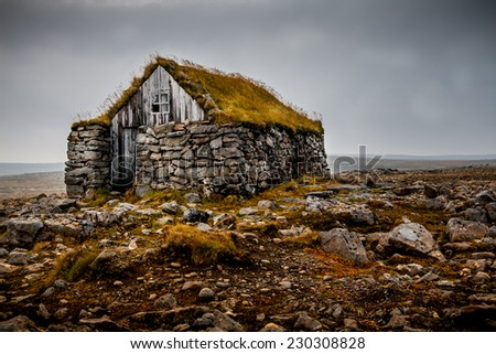 Traditional hut in the Westfjords in Iceland. - stock photo