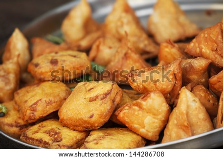 Traditional Indian dish samosa on the open market. Udaipur - stock photo