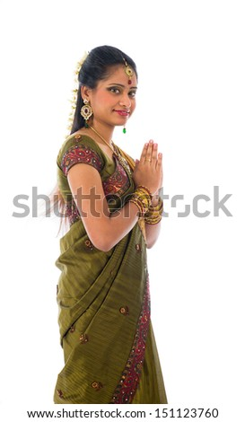 traditional indian female giving greetings during diwali - stock photo