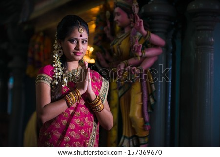 traditional indian female praying in the temple - stock photo