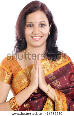 Traditional Indian girl holding hands in prayer position - stock photo