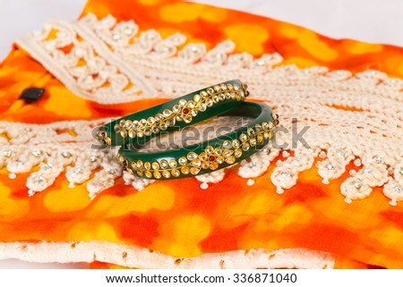 traditional indian kurta and bangle set with embroidery on kurta and carvings on bangles  - stock photo
