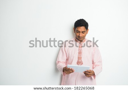 traditional indian male with tablet and plenty of copyspace  - stock photo
