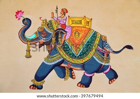 Traditional Indian or Rajasthani wall painting of elephant with jockey. - stock photo