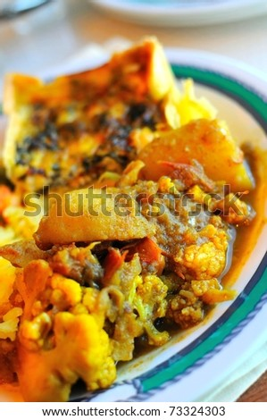 Traditional Indian vegetable curry cuisine on plate.