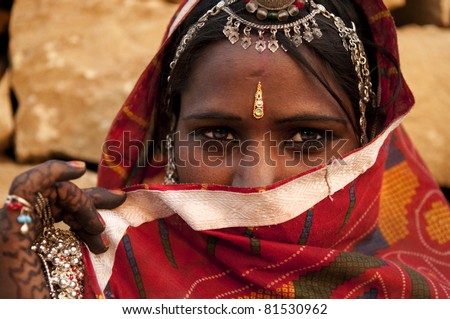 Traditional Indian woman covered her face - stock photo