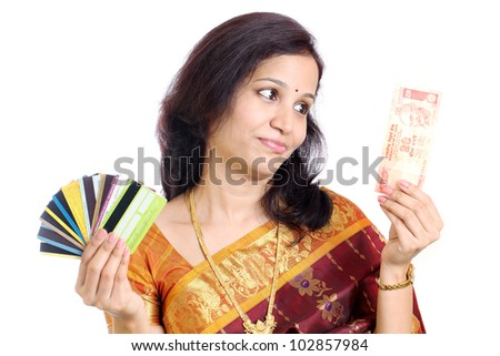 traditional Indian woman with currency notes and credit cards