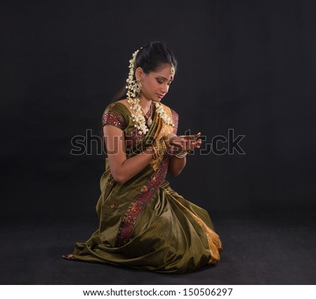 traditional indian woman with oil lamp during the celebration of deepawali or diwali