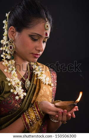 traditional indian woman with oil lamp during the celebration of deepawali or diwali - stock photo