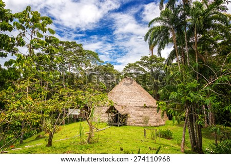 Traditional indigenous dwelling known as a Maloka in the Amazon Rainforest in Brazil - stock photo