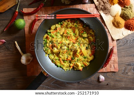 Traditional indonesian meal nasi goreng with rice, vegetables and chicken - stock photo