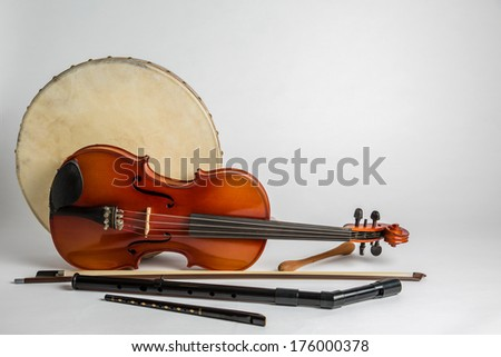 Traditional Irish musical instruments on a white background - stock photo