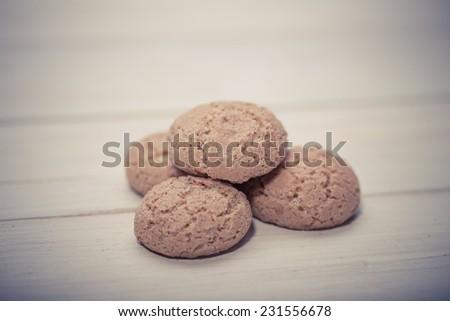Traditional italian almond cookies - amaretti, on wooden surface - stock photo