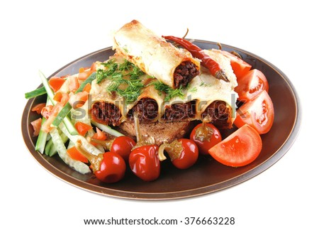 traditional italian cannelloni with mince meat and tomato - stock photo