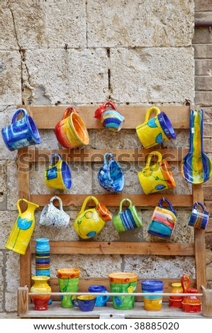Traditional Italian ceramics - on display in front of souvenir shop - stock photo
