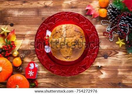 traditional italian christmas cake with chocolate and various xmas decorations free space for text