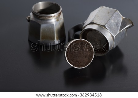 Traditional Italian coffee in the foreground with coffee already .Italy - stock photo