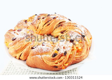 Traditional Italian Easter cakes, puff pie, sweet braided bun with raisins and candied orange - stock photo