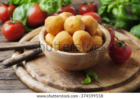 Traditional italian fried balls of mozzarella, selective focus - stock photo