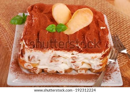 traditional italian homemade tiramisu cake on the table - stock photo
