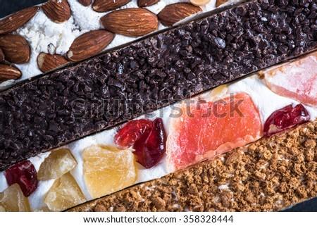 Traditional italian nougat bars, overhead, food background - stock photo