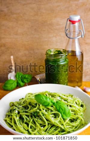 traditional italian pasta with basil pesto - stock photo