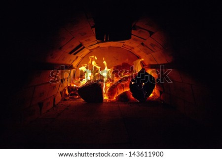 traditional Italian pizza wood oven, fire detail - stock photo