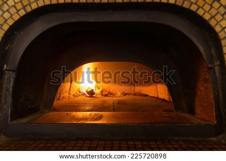 Traditional Italian pizza woodfired stone oven. - stock photo