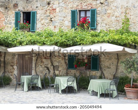 Traditional italian restaurant in Tuscany - Monteriggioni village - stock photo