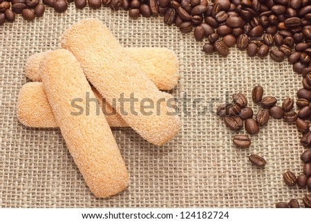 Traditional Italian sugar biscuit cookies with coffee beans on sacking background
