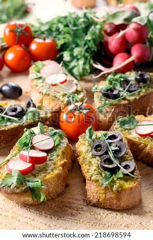 Traditional Italian vegetarian bruschettas on wooden background,selective focus  - stock photo