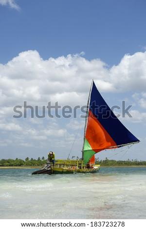 Traditional jangada sailboat sailing in Northeastern Brazil - stock photo