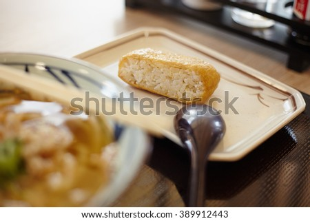 Traditional japanes rice, and udon on the served table with chopsticks
