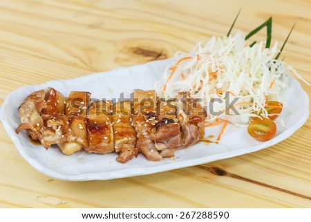 Traditional japanese food, grilled chicken or Tori teriyaki on wooden table - stock photo