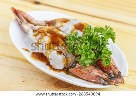Traditional japanese food, Grilled king tiger prawn on wooden table - stock photo