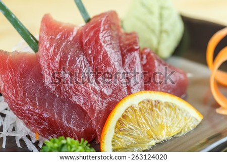 Traditional japanese food, Maguro (tuna) sashimi on wooden background - stock photo