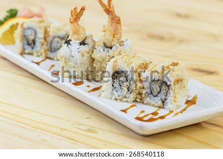 Traditional japanese food, Tempura (Shrimp) Maki Sushi on wooden table - stock photo
