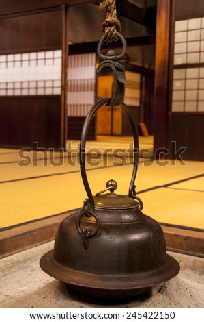 Traditional japanese home interior with tea pot over fireplace - stock photo