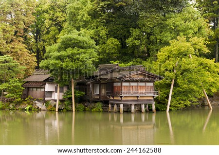 Traditional japanese house on the water columns - stock photo