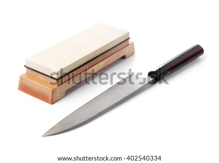 Traditional japanese kitchen knife and grinding water stone. Isolated on white. - stock photo