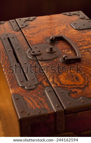 Traditional japanese ornated wooden brown chest - stock photo