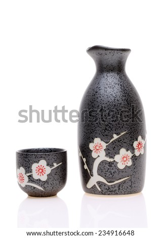 Traditional Japanese sake cup and bottle on white background - stock photo