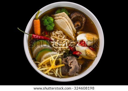 traditional japanese soup isolated on black background