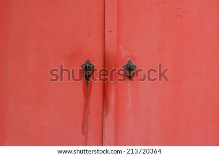Traditional Japanese style old door in red color. - stock photo