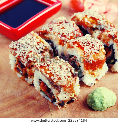 Traditional Japanese Sushi rolls with avocado,eel , caviar and rice, instagram effect, square toned image - stock photo
