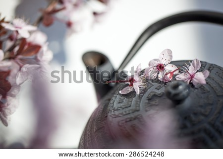 traditional Japanese teapot with cherry blossom flowers for zen and relaxation - stock photo
