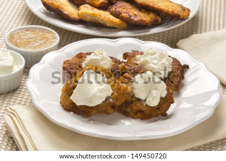 ... or potato pancakes with sour cream and apple sauce - stock photo