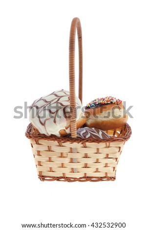 traditional jewish holiday chanuka donuts covered by dark and white chocolate pattern on retro vintage basket isolated on white background - stock photo