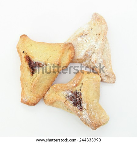 Traditional Jewish holiday food - Purim Hamantaschen, Baked ear shaped pastry stuffed with chocolate - stock photo